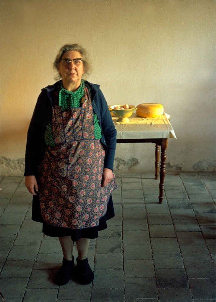 Farmers wife in cheese maker cellar 1973